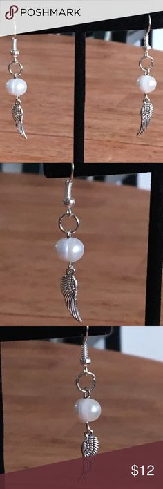 White Freshwater Pearl Silver Angel Wing Earrings These beautiful earrings are made with natural white freshwater pearls. The Angel wing charms are silver tone, and the hooks are sterling silver plated.   All PeaceFrog jewelry items are handmade by me! Take a look through my boutique for more unique creations. PeaceFrog Jewelry Earrings
