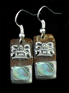 Fine earrings of pewter Aztec design incrustation on coconut with abulone shell.    Wide : 1.2cm = 0.5 inches    Large: 2.5cm = 1 inche