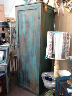 $249 - This vintage solid wood cabinet has a clothing bar so it can be used as a wardrobe it also has removable shelves if you prefer to use that as a pantry. With several layers of paint it has been heavily distressed. The cabinet measures 26 inches across the front, 25 inches deep and it stands 76 inches tall. It can be seen in booth D 8 at Main Street Antique Mall 7260 East Main St ( E of Power Rd ) Mesa 85207  480 9241122open 7 days 10 till 530 Cash or charge 30 day layaway...