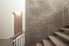 Gallery of This Hand-Laid Brick Feature Wall Was Inspired by Soundwaves in Water - 14