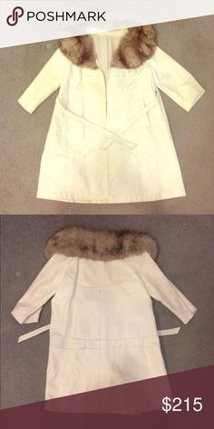 White Leather Coat w/ Fur collar and Belt Small beautiful white leather coat. Unknown maker. A shame since this Coat deserves some credit! Excellent condition, very LIGHT scuffing at the bottom of garment. Jackets & Coats