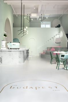 The Budapest Café in Chengdu, China, by Biasol studio is inspired by film director Wes Anderson's style - Huskdesignblog | Wes Anderson decoration | Biasol design studio | green interior | green walls | 2018 interior design trends | green-toned interior | modern café | contemporary café | sculptural interior | minimalist architecture | green chair | pink seating | marble counter | arches | minimal lighting fixtures | China coffee shop | millennials place | instagram interior design | 2018…