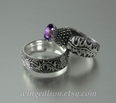 Silver shank adorned with detailed carvings of thistle leaves with a hammered texture. The bezel in the shape of thistle's flower is set with a genuine deep purple Amethyst gem. Jewelry Rings, Silver Jewelry, Jewelry Accessories, Silver Rings, Thistle Flower, Amethyst Gem, Purple Amethyst, The Bling Ring, Schmuck Design