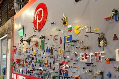 An add-yours Lego wall. | 43 Ways Pinterest's Office Is The DIY Paradise You'd Expect Talk about enjoying work because your environment is so very awesome.