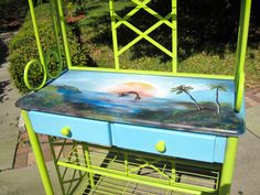 This baker's rack with jumping mermaid is available at Antiques and Uniques, Ozona, Fl., booth 36.  Art by D Dunbar