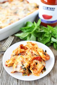 Easy Cheesy Baked Tortellini Recipe on twopeasandtheirpod.com Love this easy baked pasta dish! It freezes beautifully too!