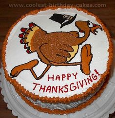 "This was a 2-layer 8"" round spice cake with apple filling, iced in cream cheese icing. The turkey image was found in an online coloring book page. I traced the image on parchment paper and filled in with buttercream; then froze it for about 20 minutes before transferring it onto the cake. Becky Z. Florida"