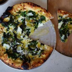 This luscious pizza uses some of spring's best and most fleeting farmers' market ingredients: green garlic and young nettles.