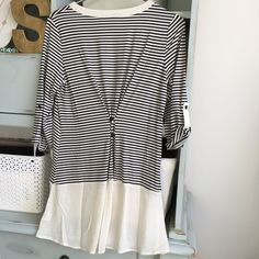 Baby and cream stripe tunic blouse The cutest stripe tunic ever. Baby and cream stripes, button fold 3/4 sleeve, long fit, adjustable buttons in back for preferred tailor look, amazing btw! NWT, fits tts. Such a perfect top, it's killer! Brina Box Tops Tunics