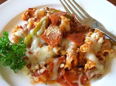 A pizza pasta casserole in a skillet. Kind of like a homemade Hamburger Helper. Quick, easy and a kid pleaser!  I use turkey pepperoni to cut way down on the grease that regular pepperoni can release.