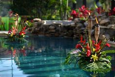 tropical theme, beach wedding, floral arrangement, pool decor, floating decor, tiki decor.