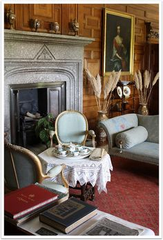 "LANHYDROCK, CORNWALL:  Low tea in the Sitting Room...Tea is served at side Chairs and Sofas, on a small  ""low"" table, cart or tray.  Only steeped  Pots of Tea are offered, no Tea Bags. 