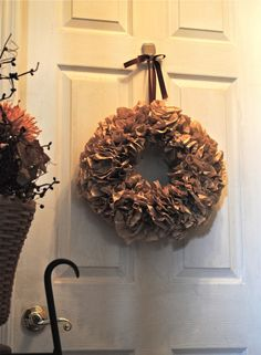 coffee filter wreath...add some fake seasonal flowers or cute knick knacks..would be ideal all year long.  So making one of these!!!