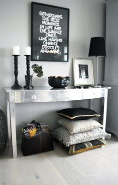 black and white entry; could add color (red) and mirror on wall instead of quote
