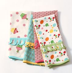 Cute dishtowels!  I like the fabric that doesn't have lent and polka dots and bright colors... love that ruffle too.