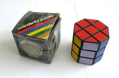 Rubik's Cylinder Puzzle https://www.etsy.com/listing/102709417/vintage-rubiks-rubiks-puzzle-game-barrel?ref=sr_gallery_39&ga_search_query=rubiks+cube&ga_ship_to=US&ga_page=11&ga_search_type=all&ga_view_type=gallery