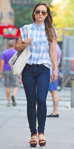 Olivia Wilde proves simplicity is stylish in her buttoned up Rails plaid short sleeve top, jeans, and platform sandals.