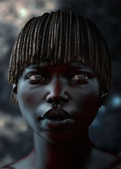 mnegm: Little african girl. The shades of blue and red within the black are very cool. Plus this little girl is stunning in an seemingly android kind of way.