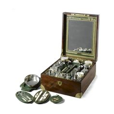 A mahogany cased French officer`s travelling dressing and breakfast set early 19th century