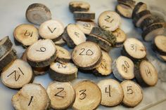 Wooden rounds-- sold with numbers or as banks... table numbers?  guests' names?  etc