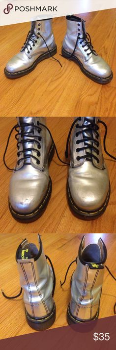 Dr. Martens The Original Air Ware Dr. Martens Silver metallic leather. Lightly used. A few scrapes on the toe. Laces don't match exactly but if you buy them I will put new laces in them. Dr. Martens Shoes Combat & Moto Boots