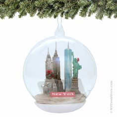 New York City Glass Christmas Ornament, Landmarks Memory Globe Featuring NYC Landmarks and famous buildings such as the Empire State Building, Chrysler Building, Freedom Tower and Statue of Liberty in this Landmarks New York City Christmas Ornament made of glass. (http://www.nycwebstore.com/new-york-city-glass-christmas-ornament-landmarks-memory-globe/)