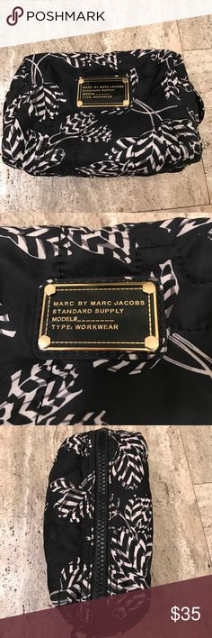 Marc By Marc Jacobs Small Cosmetic Bag Great cosmetic bag in good condition. Has been used but has tons of life left. A few small stains in inside but material can be easily cleaned. NO TRADES Marc By Marc Jacobs Bags Cosmetic Bags & Cases