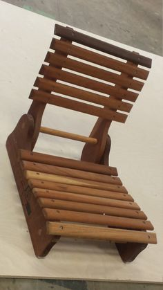 very unique folding wooden seat - originally designed to sit in the bottom of a canoe for additional seating - can be used for camping, festivals etc. - each chair has a unique combination of wood species used - 16 x 8 Folding Furniture, Home Decor Furniture, Wood Furniture, Wooden Chair Plans, Chair Design Wooden, Wooden Canoe, Wooden Boats, Wood Shop Projects, Pallet Projects