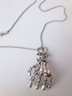 Zombie hand necklace on Etsy, 12,00$ CAD