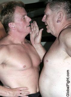 men wrestling face slapping bitch slapped man