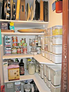 Baking pans on top shelf, platters and food wrap underneath it and gluten-free flours and dried goods in glass Ikea containers. anniehearts.com