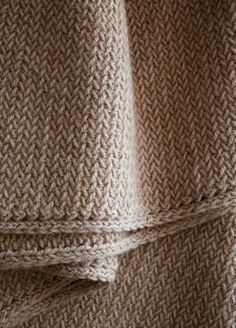 "This is like the ""My so called scarf"" that many people knit. I love the herringbone effect."