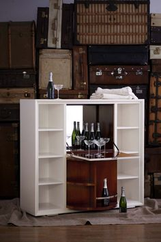The glamorous One Fifth Bar Cabinet stuns with a parchment colored lacquer finish, faux shagreen front and carousel storage