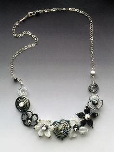 Secret Garden Medium Necklace: handmade glass lampwork beads with sterling silver components - Black & White by LisaInglertJewelry on Etsy https://www.etsy.com/listing/502098035/secret-garden-medium-necklace-handmade