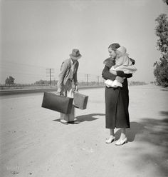 November 1936. Young family, penniless, hitchhiking on U.S. Highway 99 in California. The father, 24, and the mother, 17, came from Winston-Salem, North Carolina. Early in 1935 their baby was born in the Imperial Valley, California, where they were working as field laborers. Photo by Dorothea Lange for the Resettlement Administration.