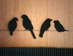birds sitting on a wire