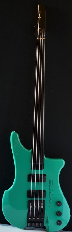 """Sea Green Kubicki Factor bass 4 string fretless bass. Company RESEARCH by #DdO:) - https://www.pinterest.com/claxtonw/bass-foundation/ - BASS FOUNDATION: If you would like to """"D"""" tune your """"E"""" string almost instantaneously, without changing string tension and not having to transpose, then the Ex Factor is your only choice. The Ex Factor 4 string bass has a 32"""" scale and allows the """"E"""" string to be released to a longer """"D"""" length of 36"""". Available with frets or fretless."""
