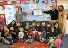 The Honiton and District Lions Club donated £329 to the Upottery Pre-school  help cover a shortfall in funding towards a new boiler.
