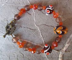 Lampwork, crystal and frosted glass bracelet. www.facebook.com/bubbasbeads