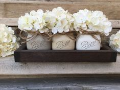 This is a farmhouse inspired tray and jars that will add charm and beauty to any room of your home. This is perfect for you coffee table, dining table, accent or dinner table. This set includes: (3) Pint Elite Jars (3) Antique White Hydrangeas (1) 6 x 12 Tray SCROLL THROUGH THE