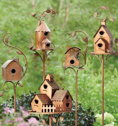 From every leaf to their curling vine tips, our whimsical Birdhouse Garden Stakes are a garden accent we love. They're intended for decorative use, but birds may try out the little entryway and like what they see. Stake into the ground in your garden or in a planter and add a little extra charm to your outdoor world. Bird Boxes, Flower Boxes, Garden Stakes, Garden Art, Garden Oasis, Garden Ideas, Traditional Birdhouses, Dog Garden Statues, House Plaques