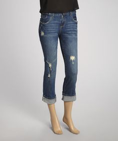 For a classic silhouette, opt for tried and true blues! This stone washed denim is fused with distressed accents for a trendy update, while the cropped finish allows for versatile styling. The mid-rise fit and stretch-blend fabric keep these jeans comfortably stylish!