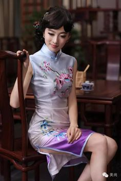 Silk qipao with embroidery. I love the traditional dresses. If they aren't silk like this one, they'll be satin. They are so pretty and so tight...feels so good to wear esp. with satin lingerie, Dixie