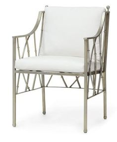 Palecek's Bodega Outdoor Arm Chair has a powder coated wrought iron frame and legs with hand-welded details finished in a pewter gold finish. With loose seat and back cushions. FREE SHIPPING.