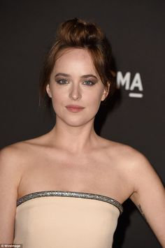 Simply piercing: Dakota's stunning hazel eyes were amplified thanks to a coat of earth-hued eyeshadow; great looks from both mom and dad - Melanie Griffith and Don Johnson.