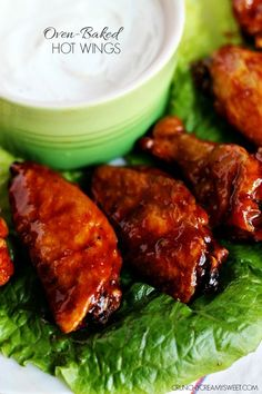 Oven-Baked Hot Wings - a healthier version for the hot wing lovers! Chicken wings baked in the oven to a crispy perfection and tossed in a sweet and spicy sauce. These wings are fantastic!  #recipe #snack crunchycreamysweet.com