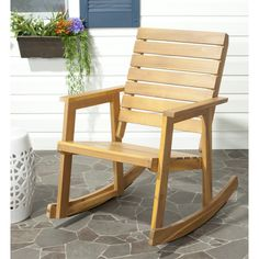 Take a rock on the wild side. The rustic chic style of the Alexei rocking chair is a modern spin on the seating choice of grandmothers around the globe. Crafted with acacia wood in teak-brown finish, it will be the great part of being outdoors. Wooden Rocking Chairs, Outdoor Rocking Chairs, Patio Cushions, Patio Chairs, Adirondack Chairs, Bag Chairs, Office Chairs, Wood Patio, Patio Seating