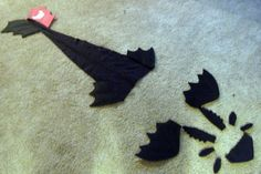 Toothless costume pieces..... put the tail on a belt and sew the other parts onto a hoodie toothless costume, belt, costum piec