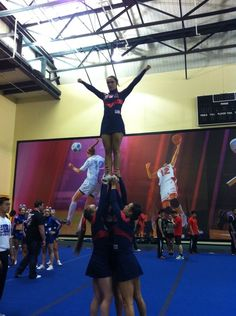 Team USA's All Girl Stunt Group is on the warm-up mat at ICU Worlds Cheer.