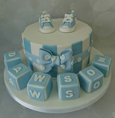 lovely christening cake with booties and blocks